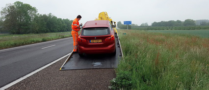 Image of a Broken Down Car Being Recovered by a Breakdown Truck