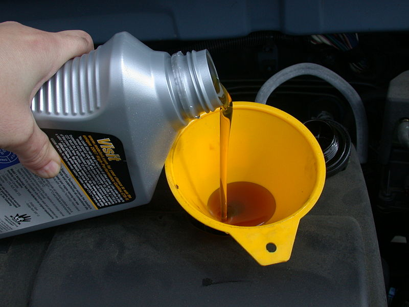 An Image Showing a Vehicle's Oil Being Topped Up