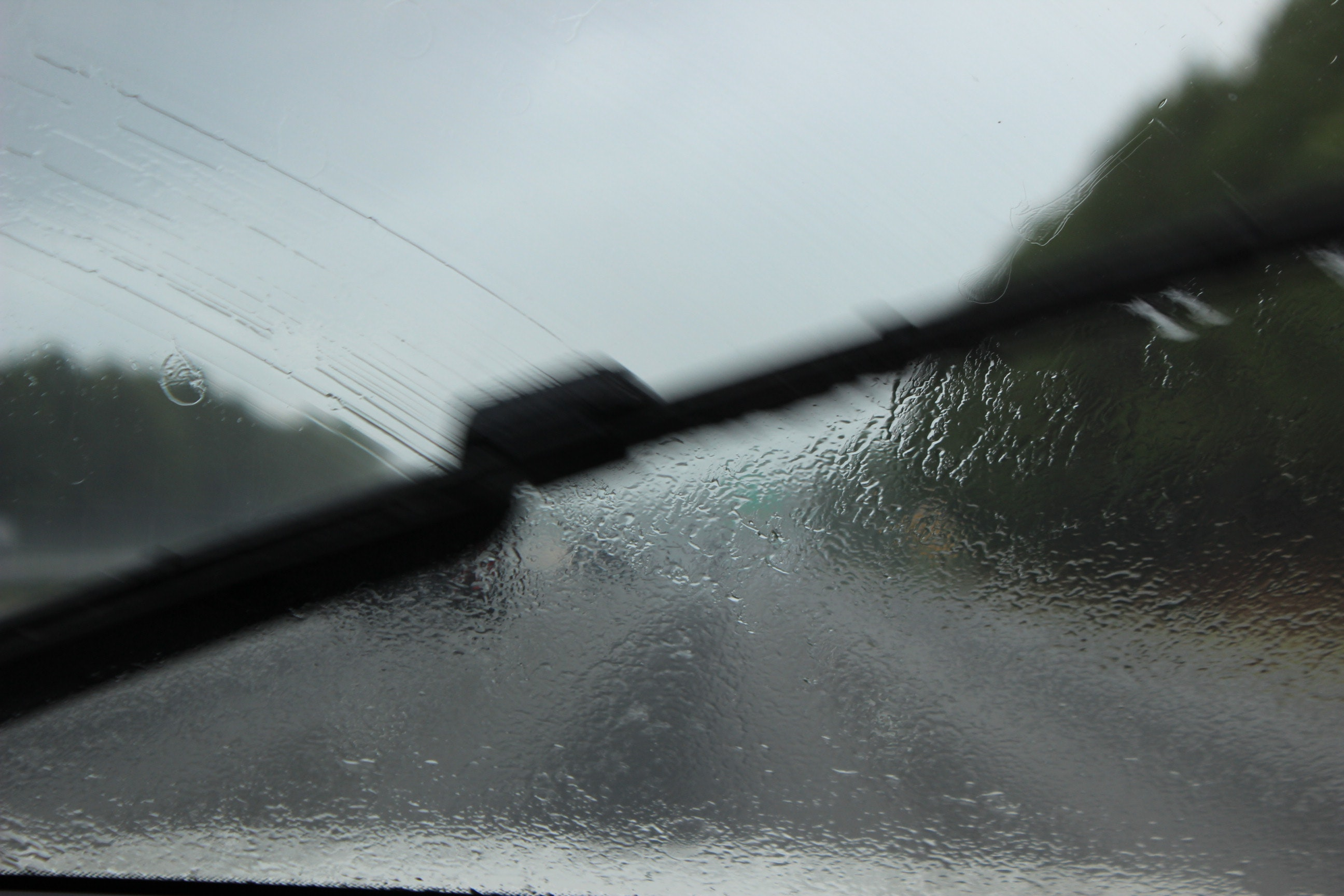 An Image Showing Vehicle Windscreen Wipers Clearing the Windscreen